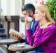 Женщина пьёт кофе, мужчина читает книгу